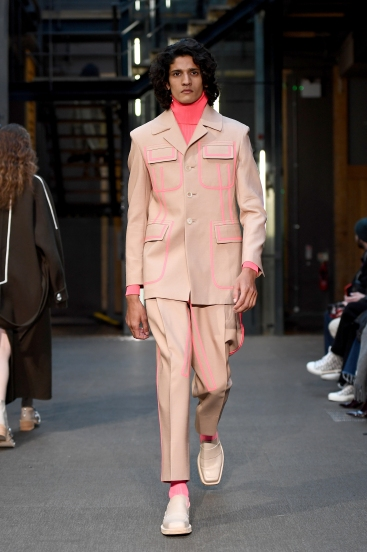 A model walks the runway at the Pronounce show during London Fashion Week Men's January 2019 at 30 Fashion Street on January 5, 2019 in London, England.